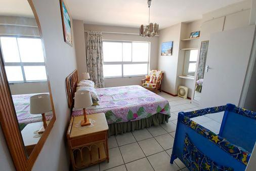 1/17 - Main bedroom with double bed and baby cot & en-suite shower/toilets/wash basin