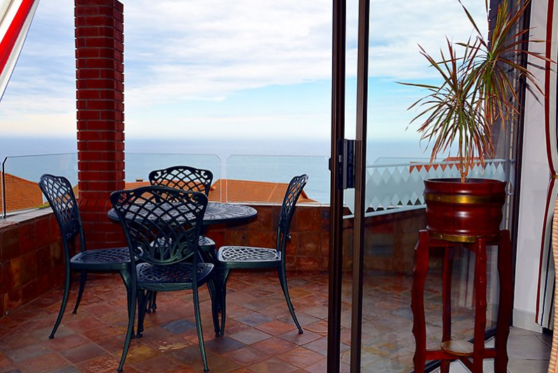 Covered balcony with 180º sea views