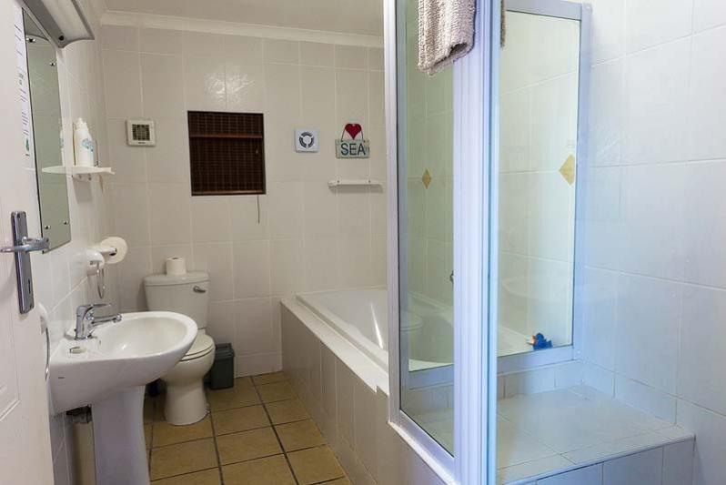 En-suite bathroom to main bedroom with bath & shower