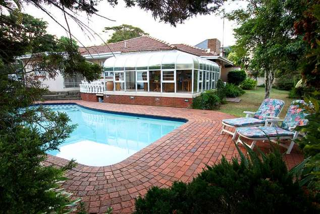 1/12 - Pool and braai area - Braemar Guest House, Bed & Breakfast Accommodation in Durban North