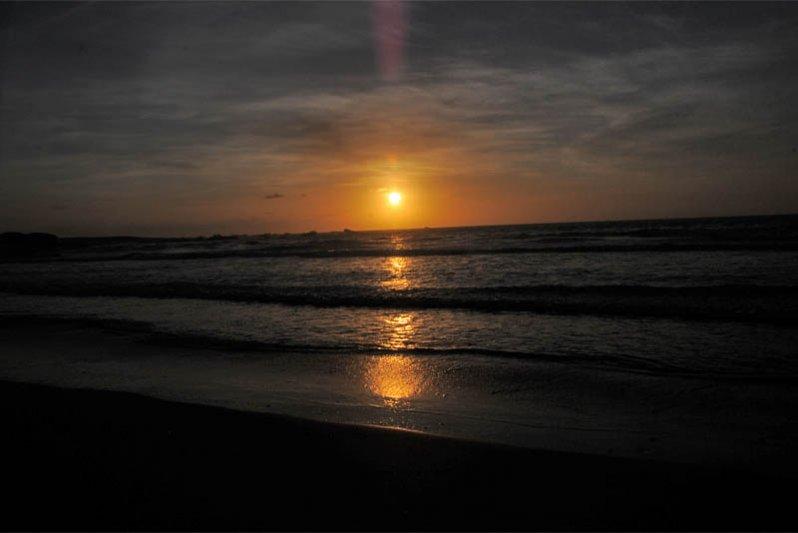 Sunset on beach in front of Die Vissershuisie