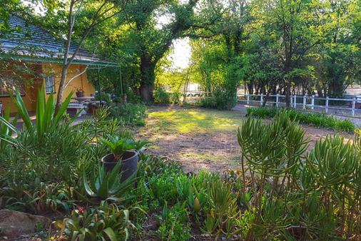 1/16 - The main guesthouse which overlooks the horse paddocks