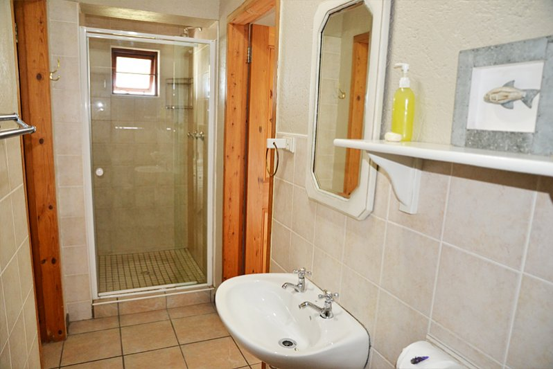 Shower and toilet for 2nd bedroom.