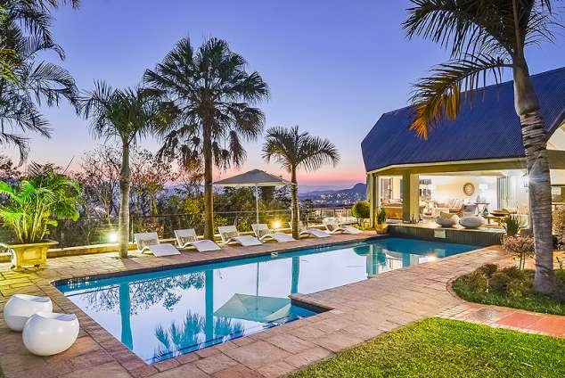 1/15 - Pool and outside lounge - Star Graded Guest House Accommodation in Mbombela, Mpumalanga