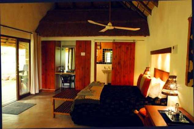 1/8 - Lodge Chalet interior -Bed & Breakfast Accommodation in Komatipoort