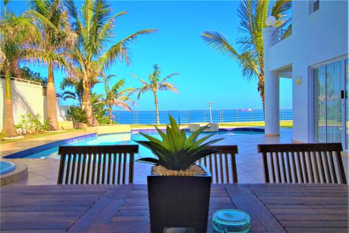 1/17 - Sea-facing lounge Ground floor Apartment opens out onto sea view patio