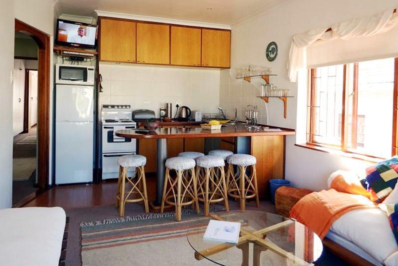 UPSTAIRS open-plan lounge-dining-kitchen