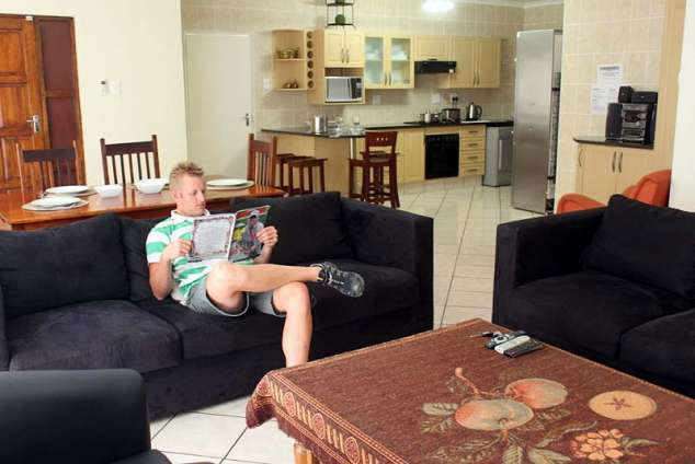 1/8 - Spacious open-plan Living area with TV & Dstv