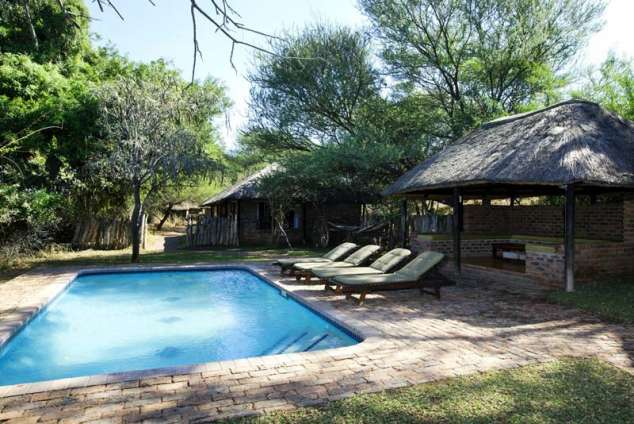 1/8 - Thatched Chalets