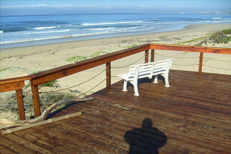 Walk about 70m onto the wooden deck on the secluded beach in front of the cottages