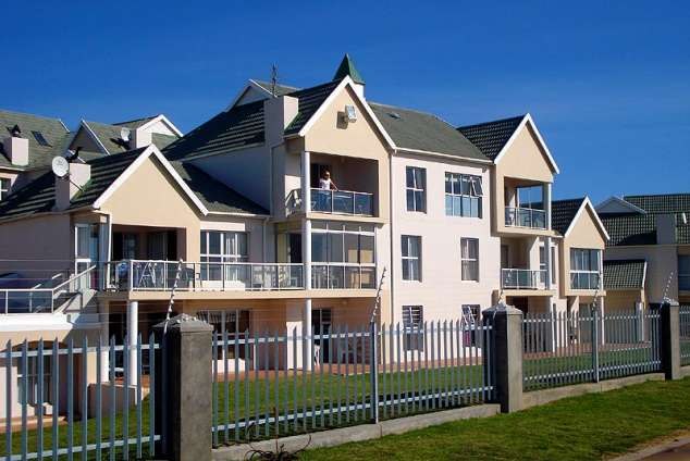 1/12 - Owner standing on balcony - Self Catering Apartment in Summerstrand