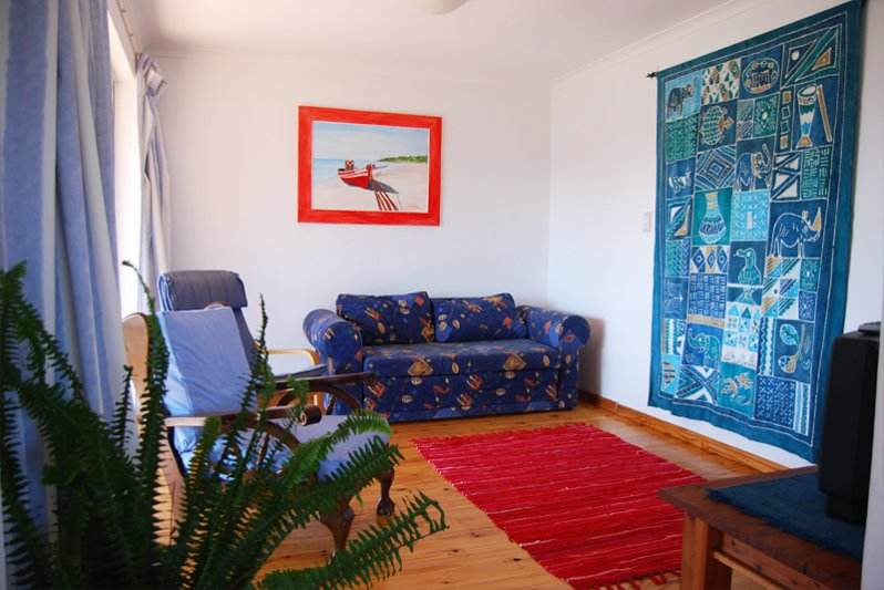 TV room with flat screen TV and open view channels. Bring your own decoder for more channels.