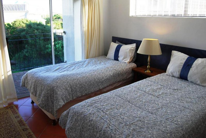 Bottom bedroom with two single beds that can be pushed together to make a king