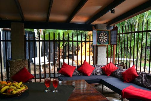 1/15 - House entertainment area. Gas braai. Wood BBQ. Pool