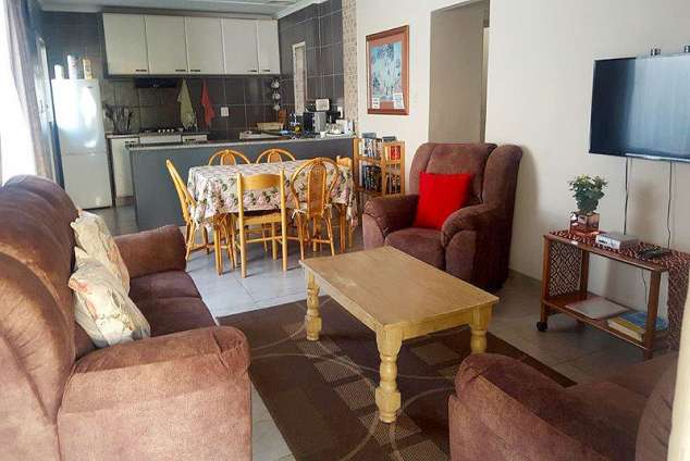 1/12 - The open-plan lounge/dining room/kitchen