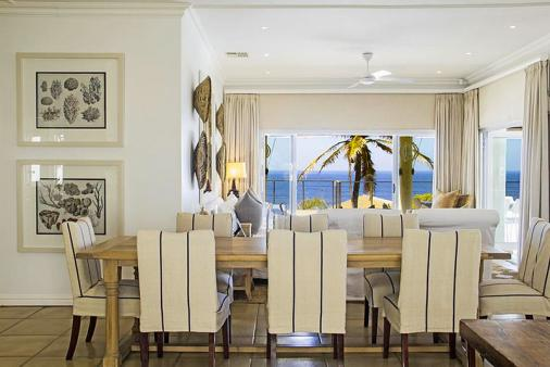 1/9 - Open plan lounge, diningroom, TV room and kitchen loking out to sea