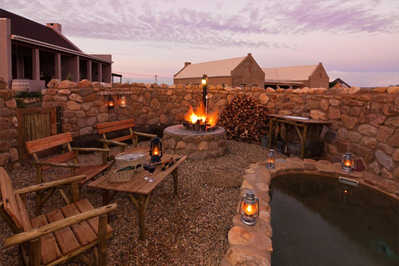 Lovely boma with braai area and plunge pool at Karoo View Cottages