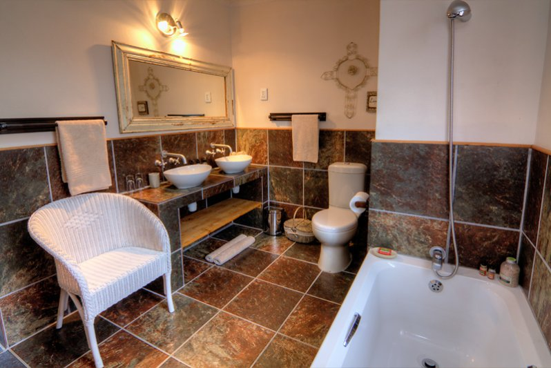 En-suite Bathroom with bath and double vanities in 2 of our Karoo View Cottages