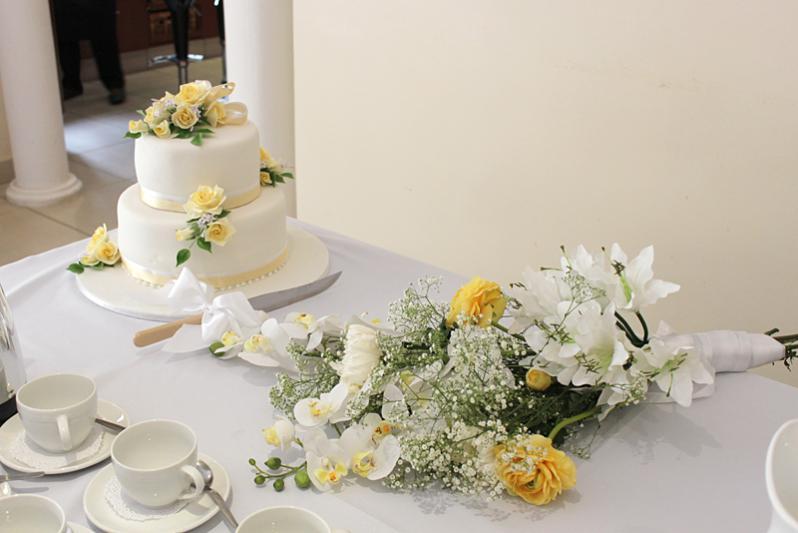 Ninety North arranges wedding cake, flowers etc