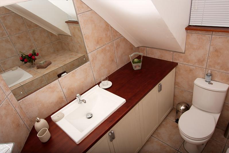 En-suite bathroom upstairs at main bedroom