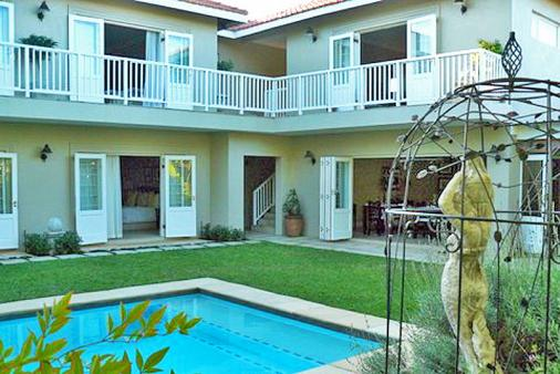 1/8 - The rooms all have French doors leading out onto the pool and private garden