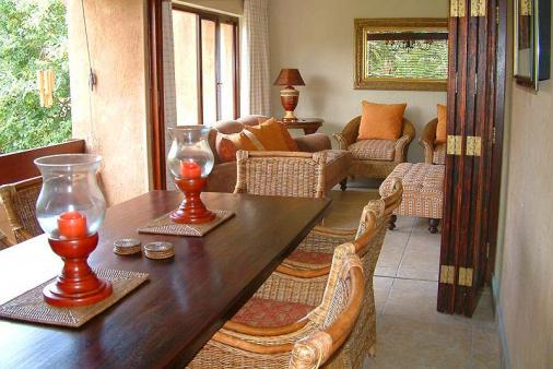 1/21 - Dining area on the top deck - Self Catering Holiday Accommodation in San Lameer, South Coast