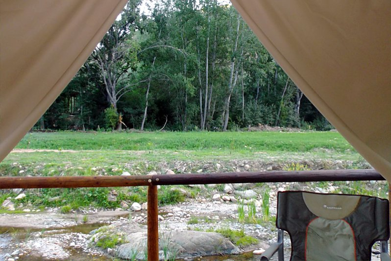 luxury riverfront tents view