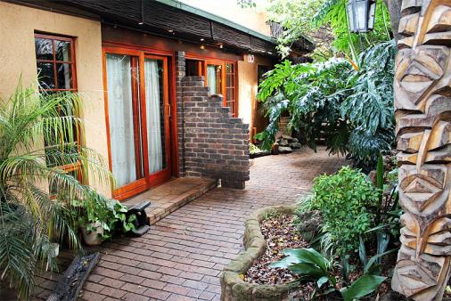 1/12 - All Guest Rooms lead out onto beautiful Tropical gardens, hiding the fact that you are in Jo'burg