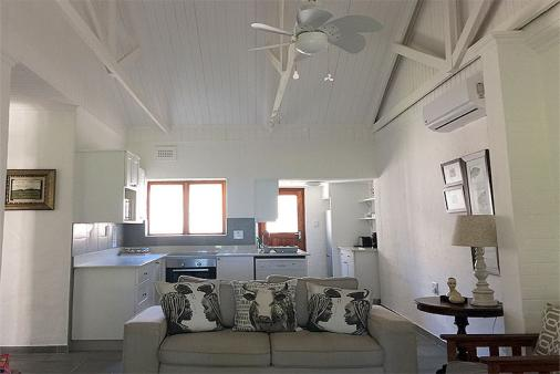 1/19 - Open plan lounge/kitchen area with full kitchen, vaulted ceilings and aircon