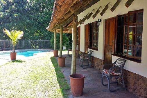 1/21 - Mdoni pool area - Self Catering Cottage accommodation in Salt Rock