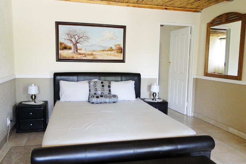 Main Bedroom Nr 1 with interleading bedroom for the kids & ensuite bathroom.