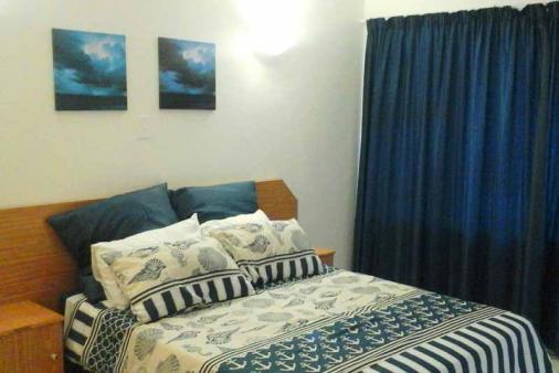 1/16 - Sea-theme main bedroom - Stella Maris 106 - Self Catering Apartment in Amanzimtoti