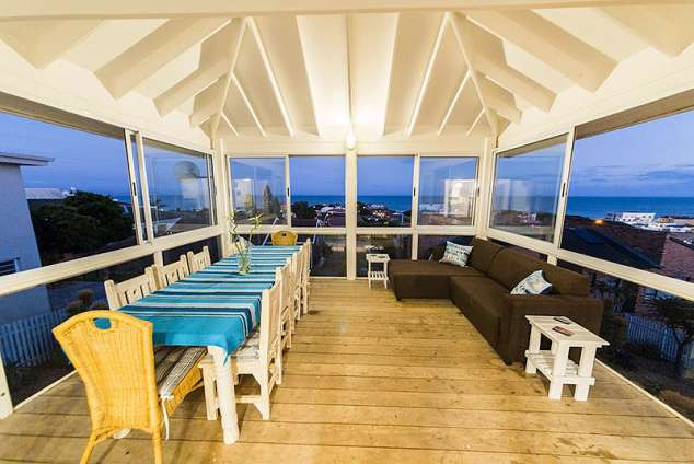 1/16 - Enclosed outdoor deck area with sea views