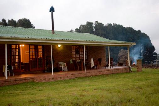 1/13 - Outside view of chalet with large patio and braai area