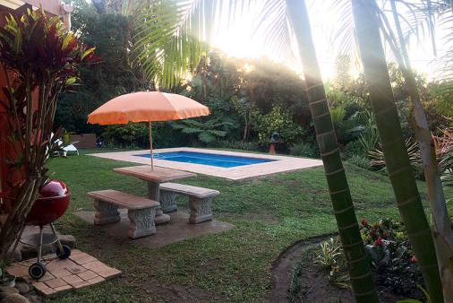 1/11 - View of garden with pool