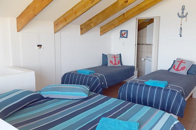 Bedroom 3. 1 x Double Bed and 2 x SIngle beds. En-suite bathroom